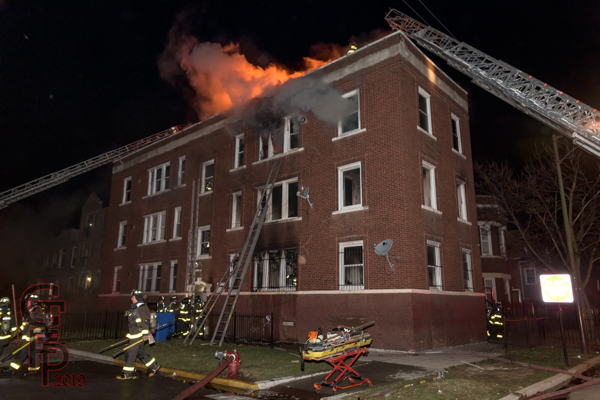 fire through the roof of an apartment building