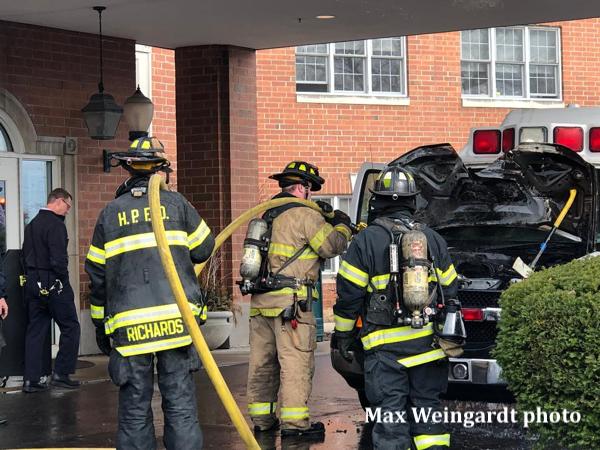 Firefighters extinguish ambulance fire