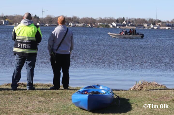 fire department divers search a lake