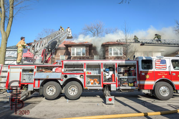 E-ONE platform aerial and E-ONE aerial ladder at fire scene