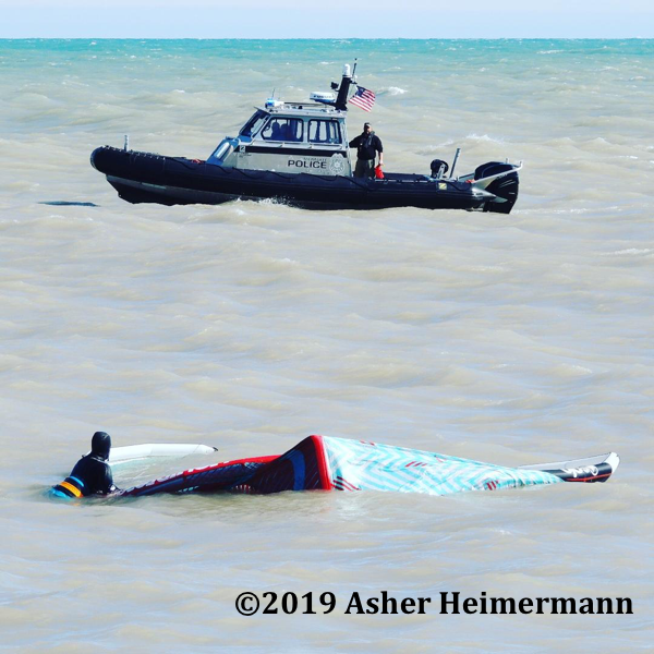Milwaukee Police Department Marine UNit with kite surfer in distress