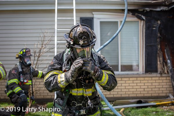 Firefighter covered with debris after fighting a fire