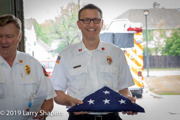 retired Firefighter receives American flag