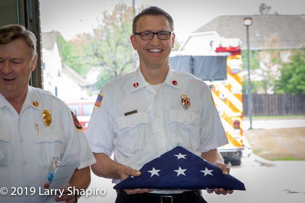 retired Firefighter receives American flag