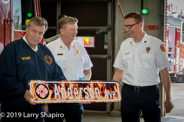 retired Firefighter receives honorary street sign