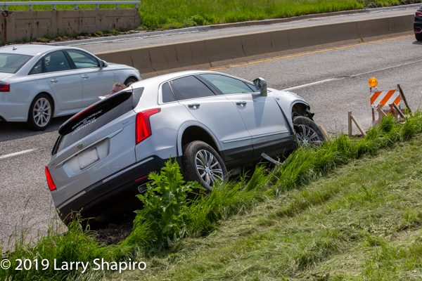 brand new Cadillac SUV wrecked