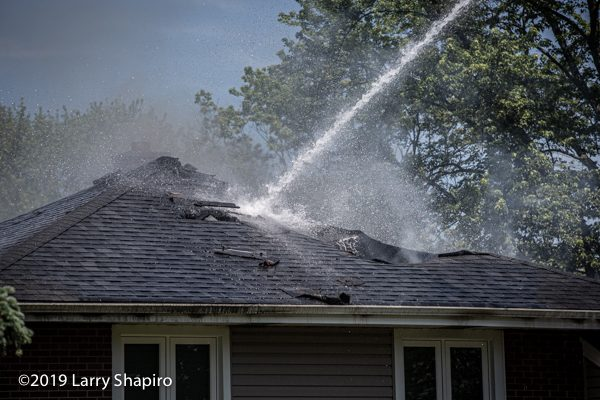 master stream directed at roof of house fire