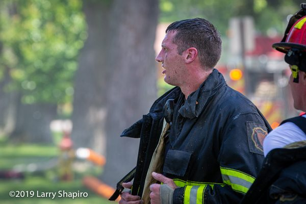 dramatic photo of Firefighter after battling a fire