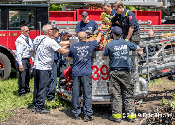 Firefighters remove victim in stokes basket