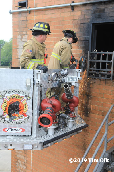 Firefighters training on truck company operations