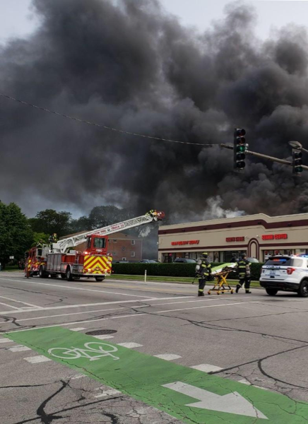 heavy black smoke from commercial building fire