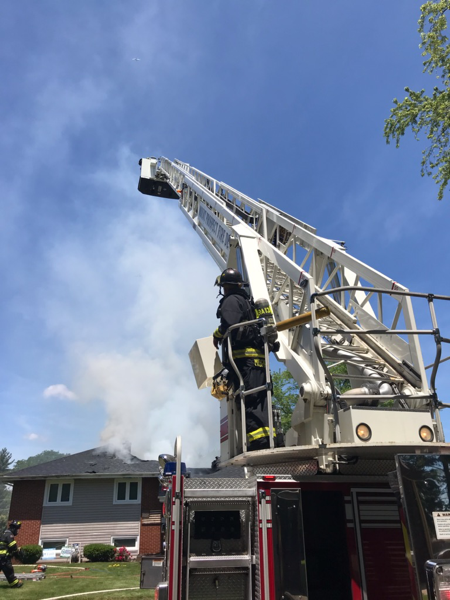 tower ladders up at house fire