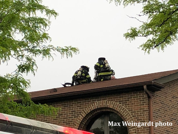 Firefighters on building roof