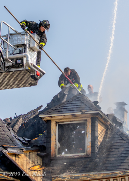 Firefighters work on roof during high heat index