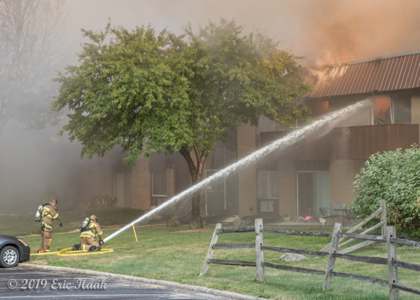 heavy smoke as Firefighters battle apartment building fire
