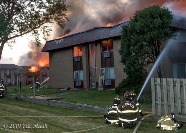 Firefighters battle apartment building fire