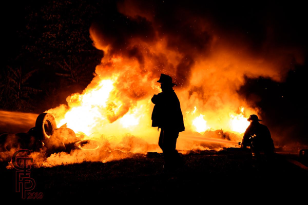 pile of tires burning at night