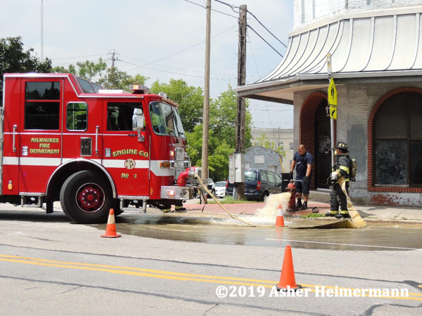 Firefighter flushing a hydrant