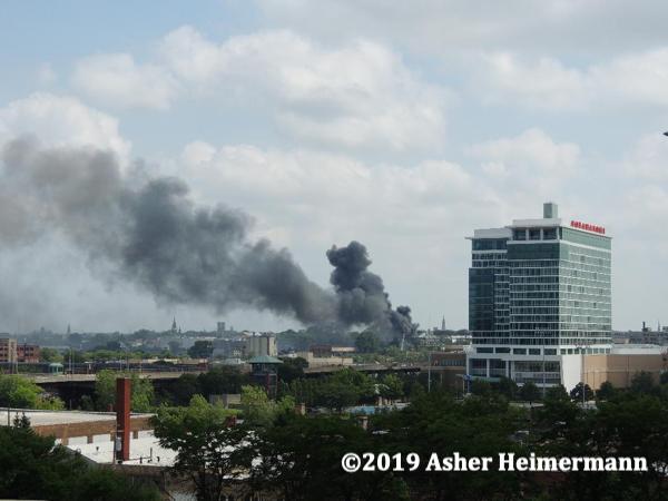 massive smoke column from building fire