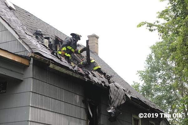 Firefighters overhaul attic after house fire