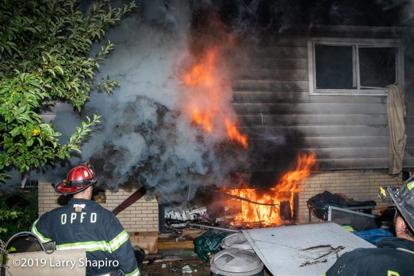 flames engulf house