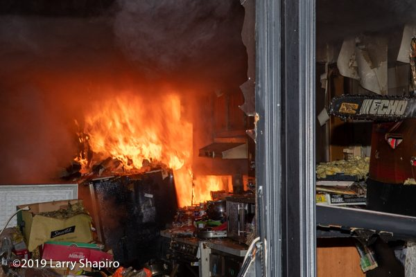 flames engulf hoarder's kitchen