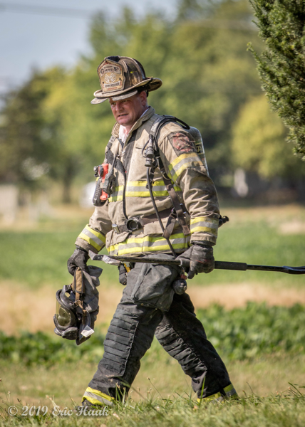 dramatic portrait of salty firefighter with PPE