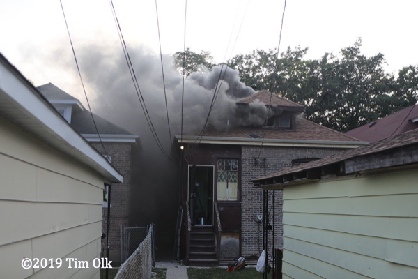 smoke from a  Chicago bungalow on fire