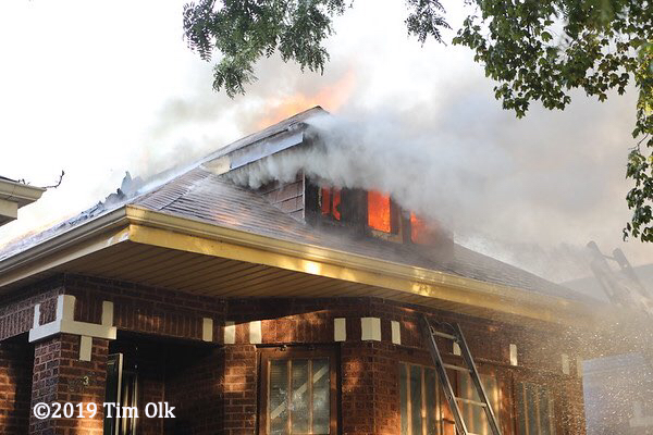 flames through roof of Chicago bungalow