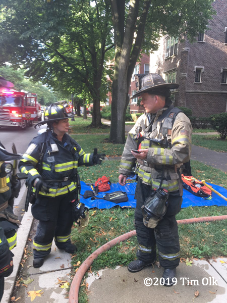 fire chief and Firefighter at fire scene