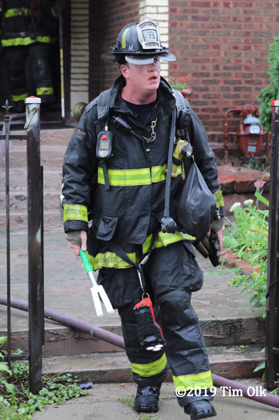 Firefighter in PPE with hand tools