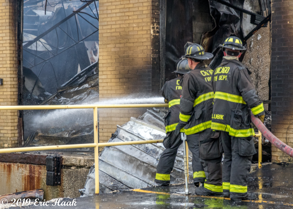 mopping up hot spots at a fire scene