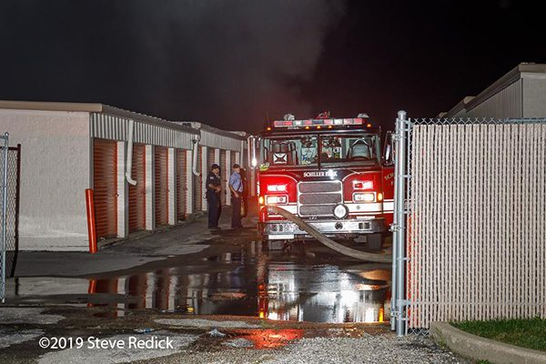 firefighters battle fire in a self storage facility