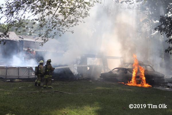 firefighters battle a car fire