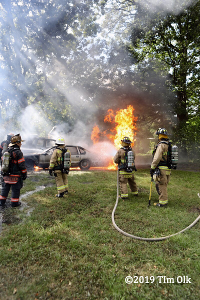 firefighters battle a car fire