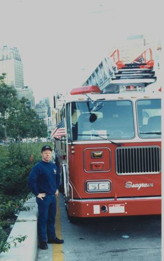 Firefighter with new fire truck at the World Trade Center on 9/12/01