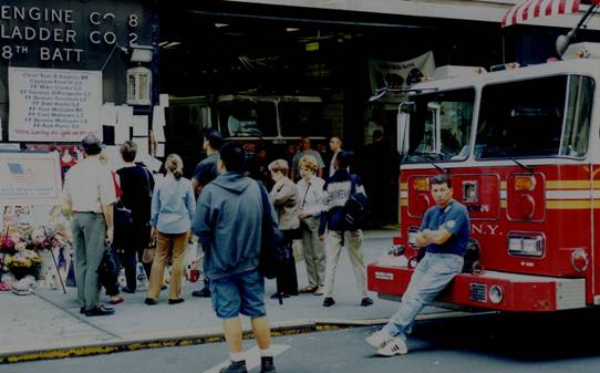 memorials outside a NYC fire station on 9/12/01