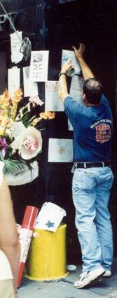 cards are posted at a fire station after the attacks of 9/11/01