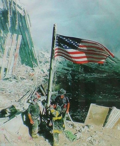 Firefighters with American Flag at ground zero on 9/12/01