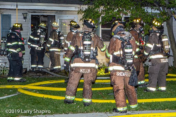 Firefighters covered with drywall after house fire