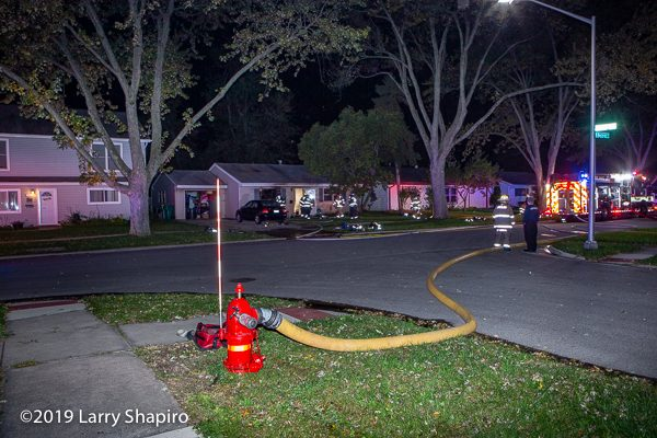 supply line on hydrant at house fire