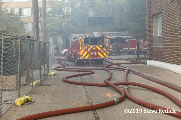 fire engines with hose on the ground