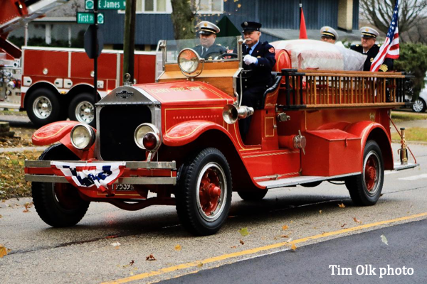 vintage fire engine carries casket