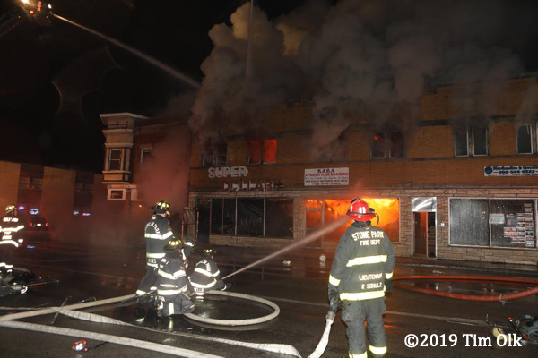 commercial buildings engulfed by fire