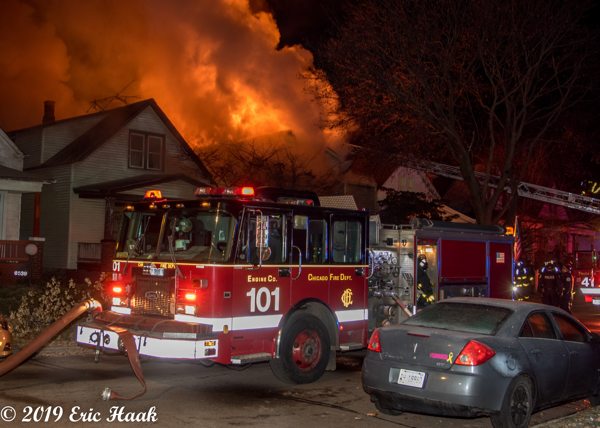 heavy fire burns from house at night