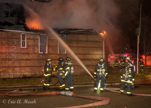 Firefighters working at night with hose line