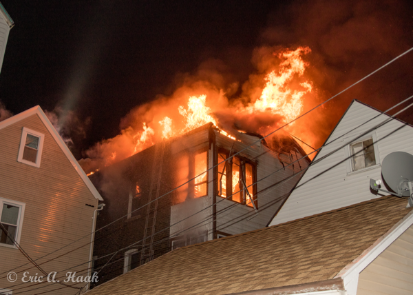 2nd floor engulfed in flames at night