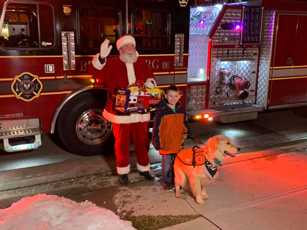 Santa, a boy, and a fire truck toy