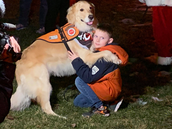 boy with service dog named Ryan