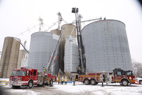 fire trucks at grain silo